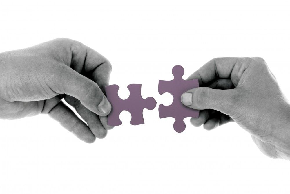 Top 10 Blog Posts: Two Hands Matching Puzzle Pieces